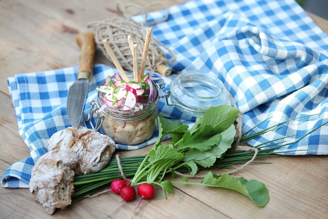 Obatzda (Bavarian cheese spread) with radishes, chives and bread