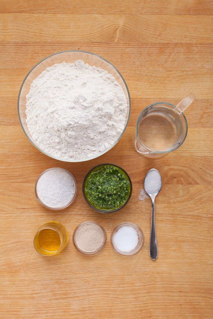 Ingredients for snail-shaped bread with pesto