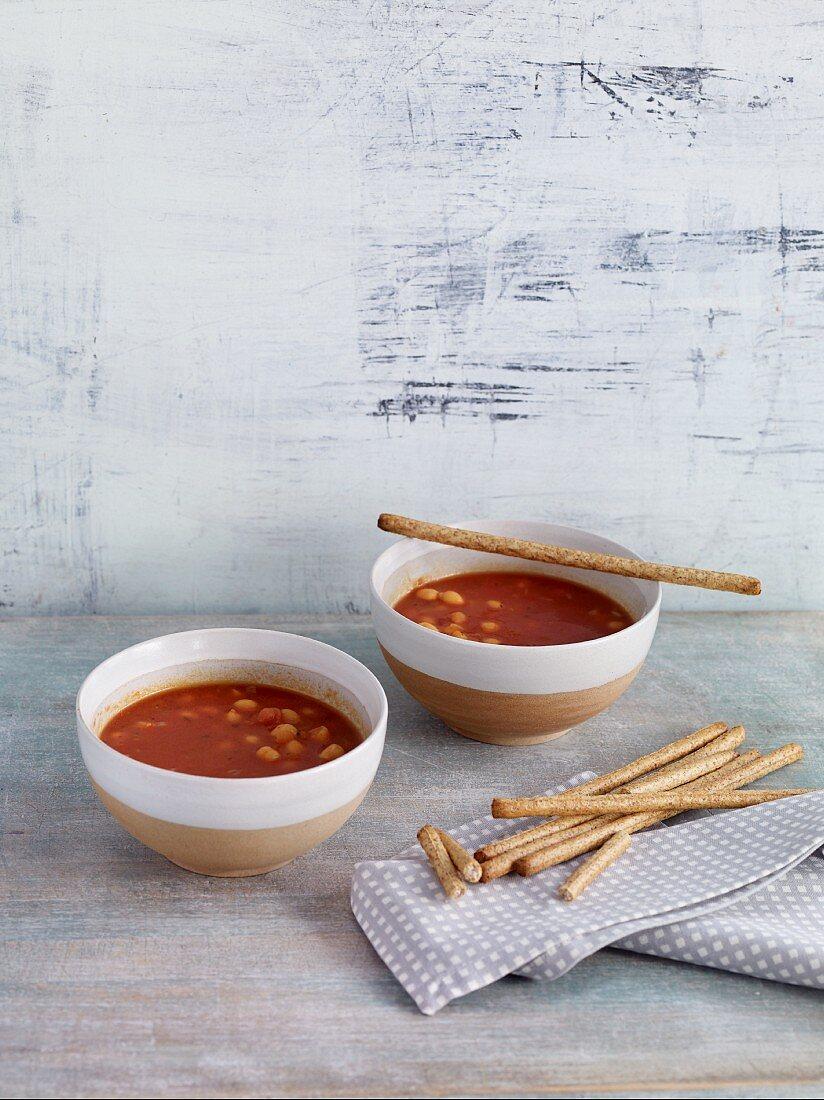 Vegan chickpea and tomato soup with orange juice