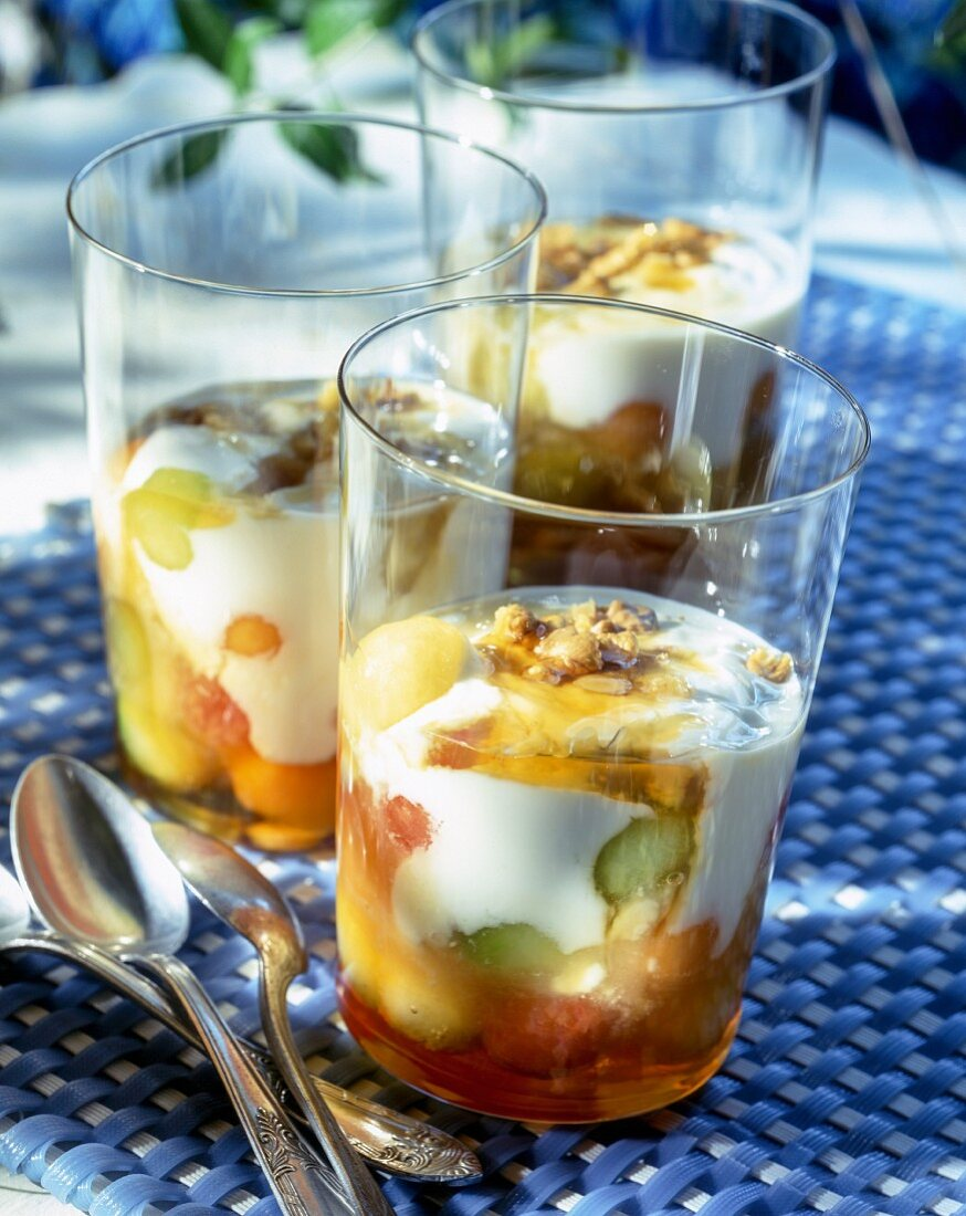 Muesli with fruits and quark on a table outdoors