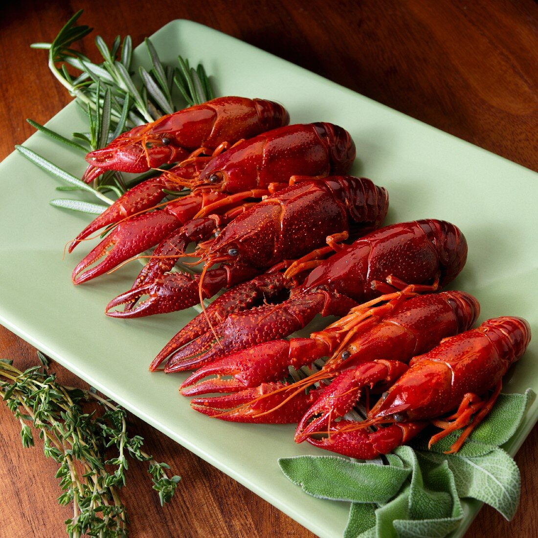 Boiled crayfish with herbs on a serving platter