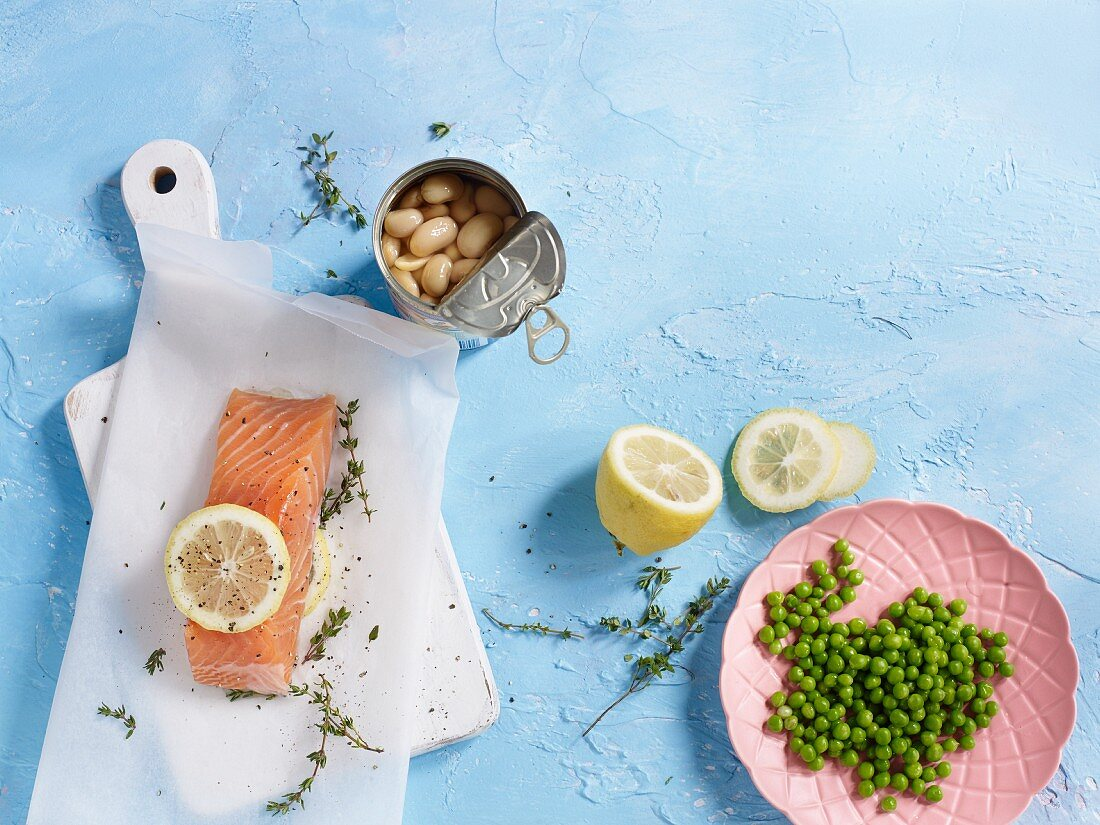 Ingredients for salmon in parchment paper with peas