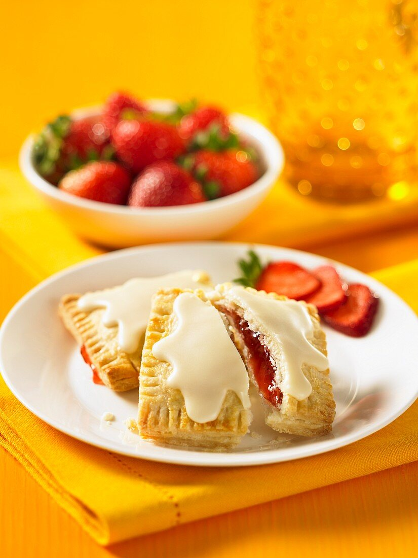 Strawberry parcels with icing