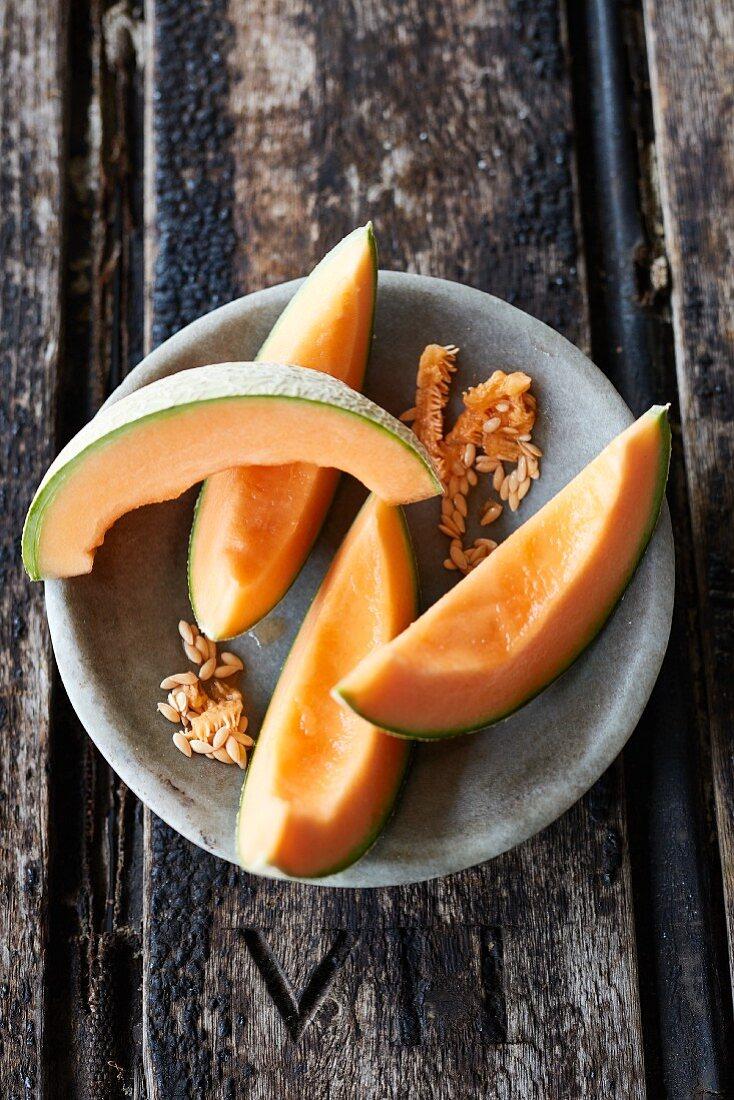 Melon slices in a stone bowl