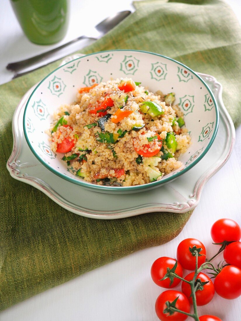 Quinoa with tomato, red bell pepper, green bell pepper, fresh Pachino tomatoes and fresh mint and italian extra virgin olive oil, Italy