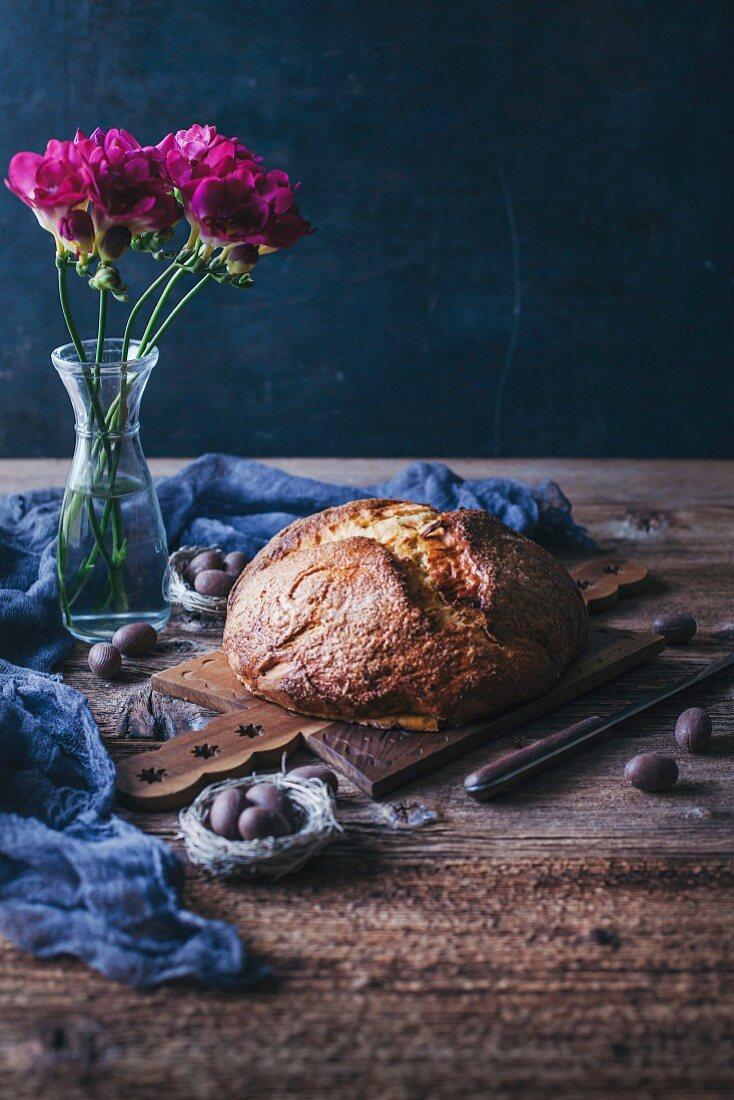 Freshly baked sweet Easter bread on a wooden board