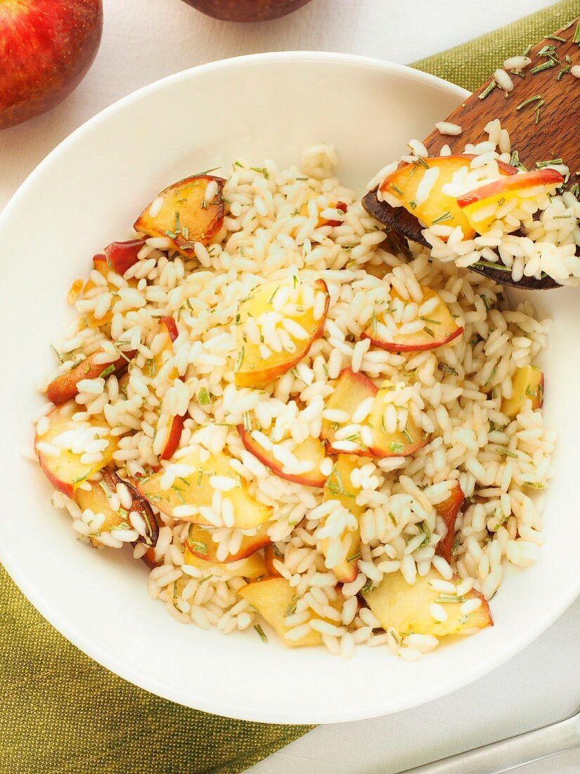 Risotto with apples, traditional dish of the Valtellina valley with rice, local apple and herbs, Lombardy, Italy, Europe