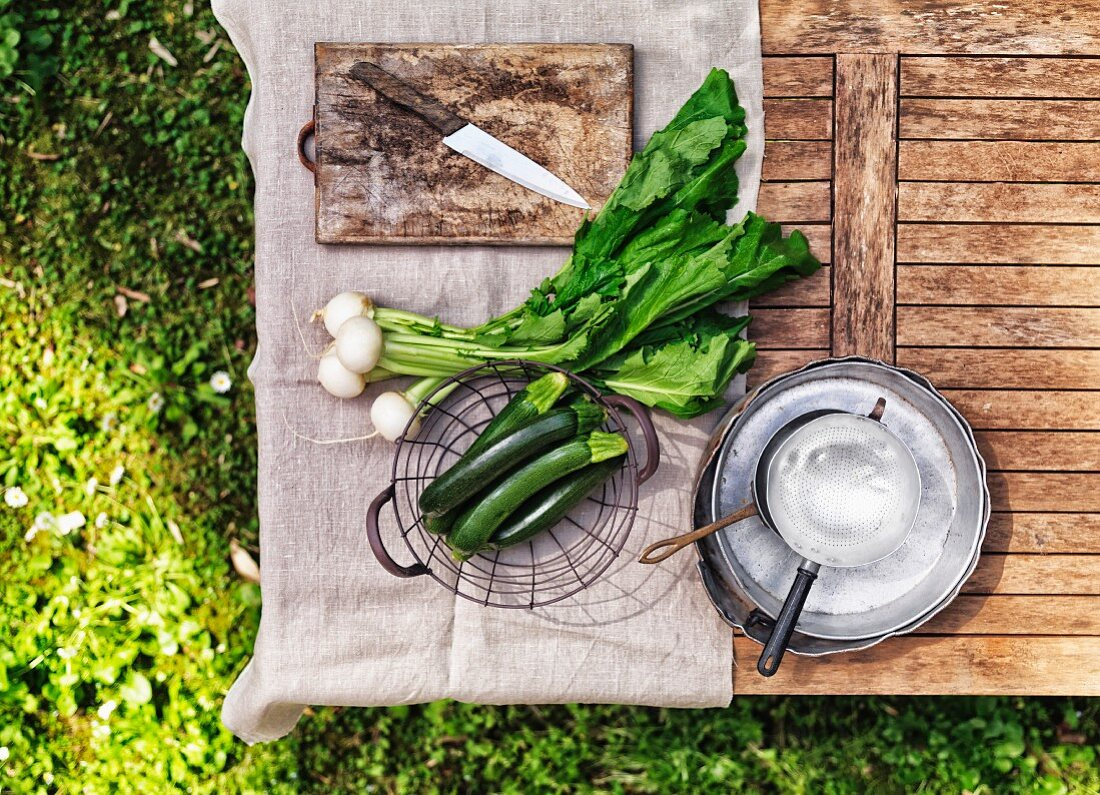 White turnip and zucchini on a table in the garden