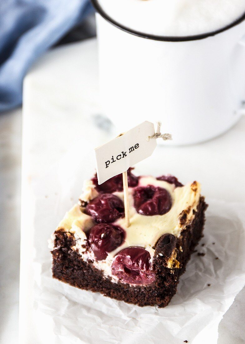 A cheesecake brownie with sour cherries