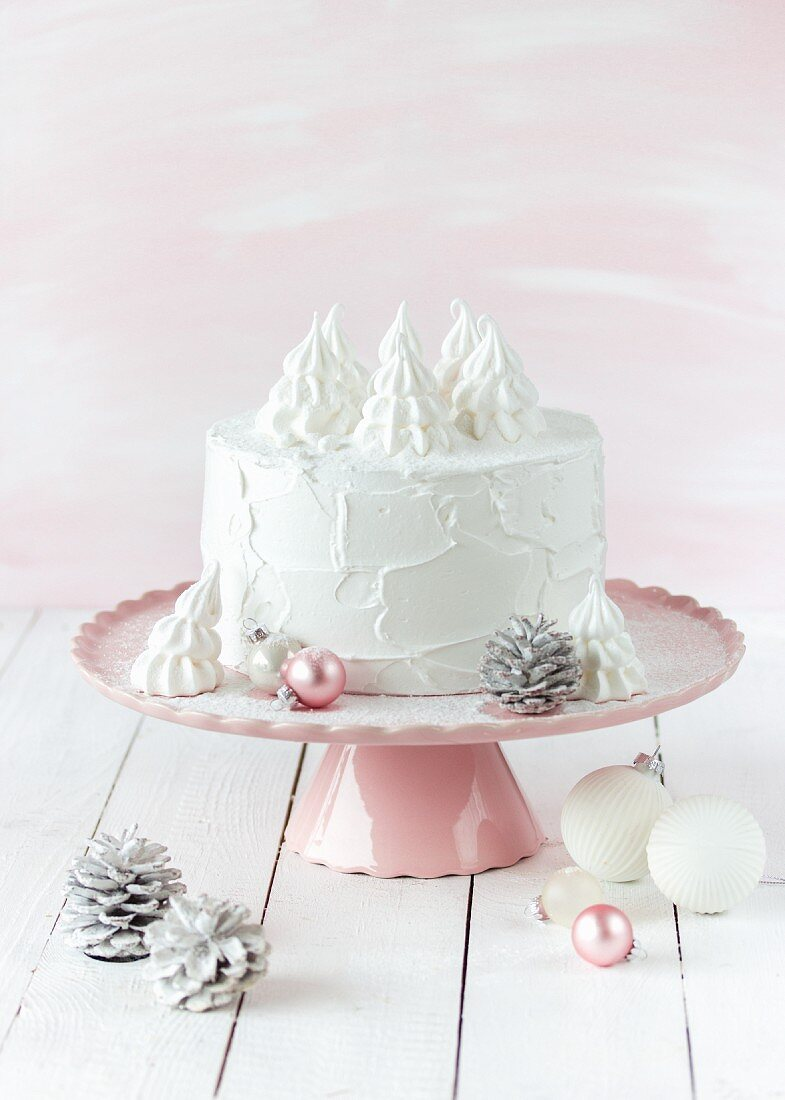 A Black Forest Christmas cake on a cake stand