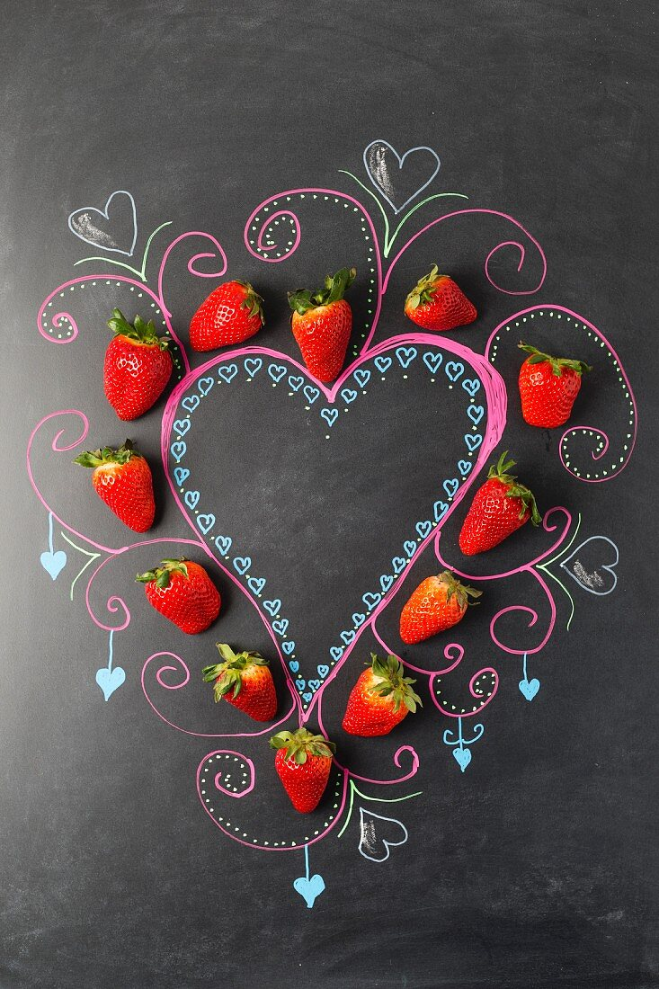 A strawberry heart and chalk decorations