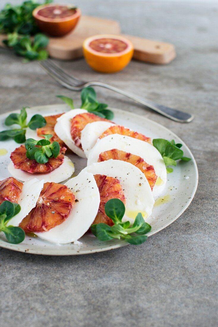 Blood orange and mozzarella salad with lambs lettuce