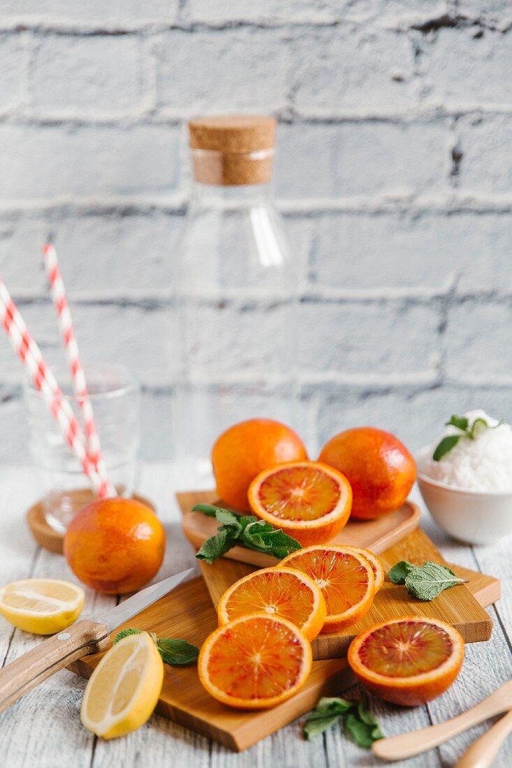Ingredients and kitchen utensils for making blood orange smoothies