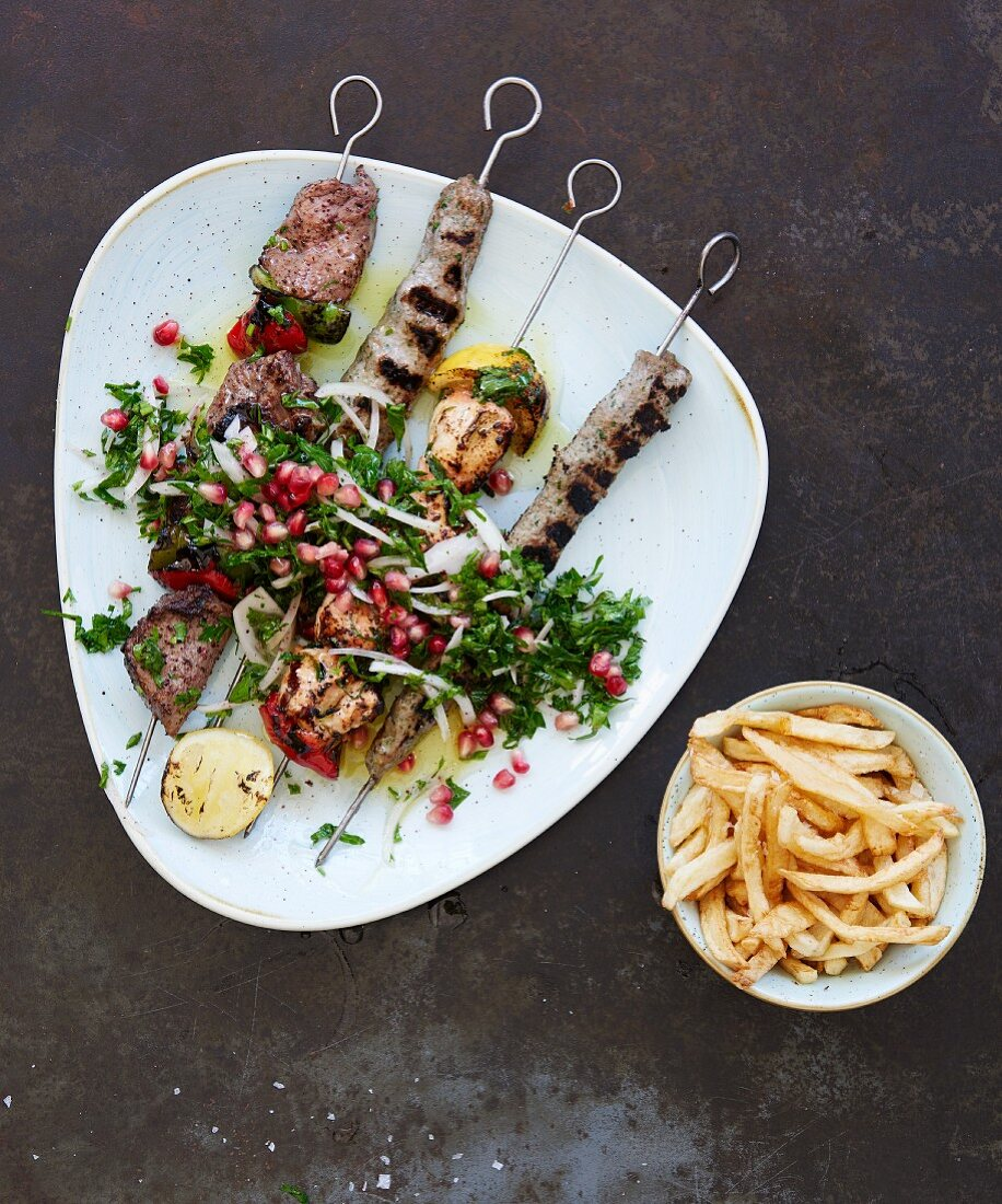 Various grilled meat kebabs with French fries (Lebanon)