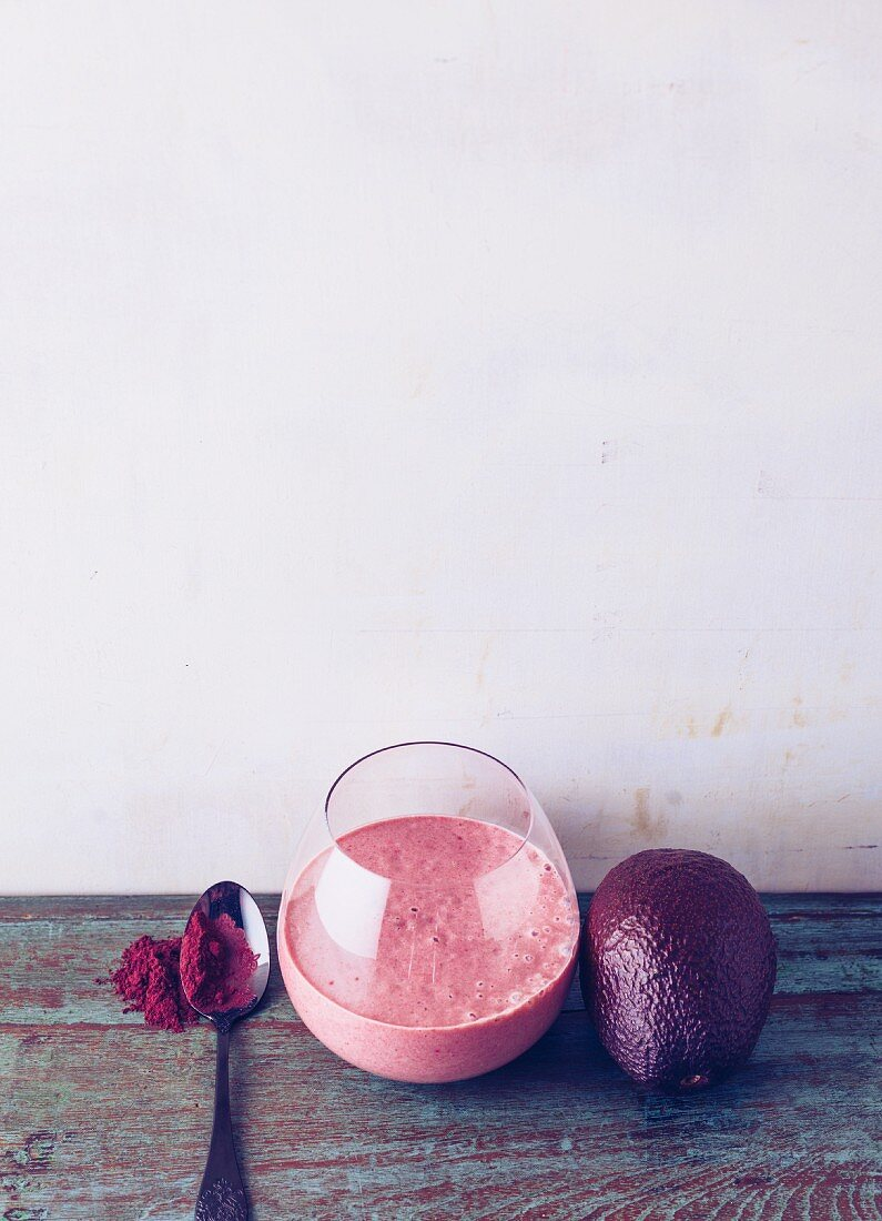 Avocado and aronia berry almond drink with peach and goji berries