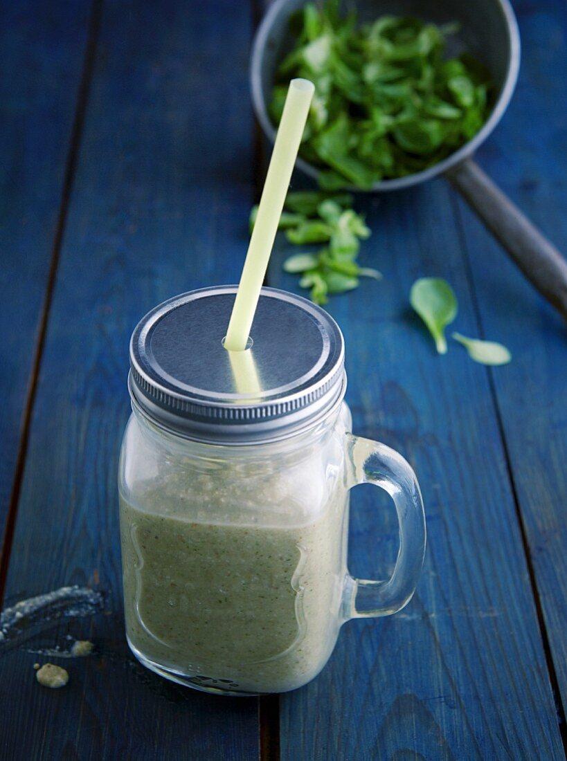 A green banana and rice shake with wheatgrass powder