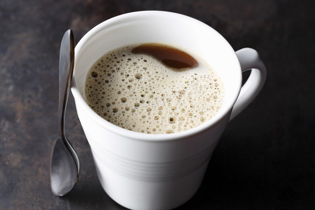 Bulletproof coffee with ground coffee, butter and coconut oil