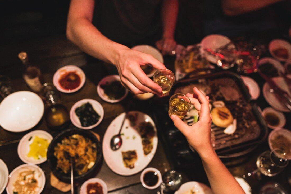 Saying cheers with sake (rice wine)