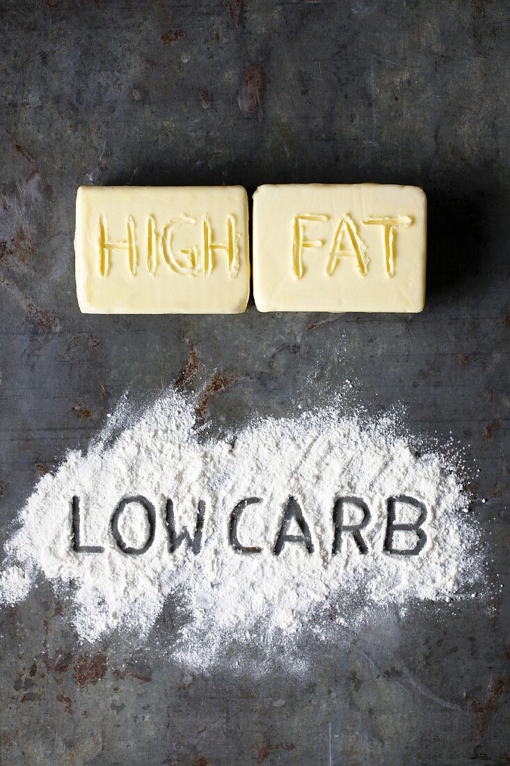The words 'high fat' and 'low carb' spelled out in butter and flour