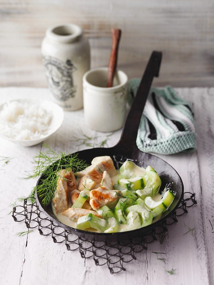 Chicken strips in a creamy sauce with dill and mustard cucumber