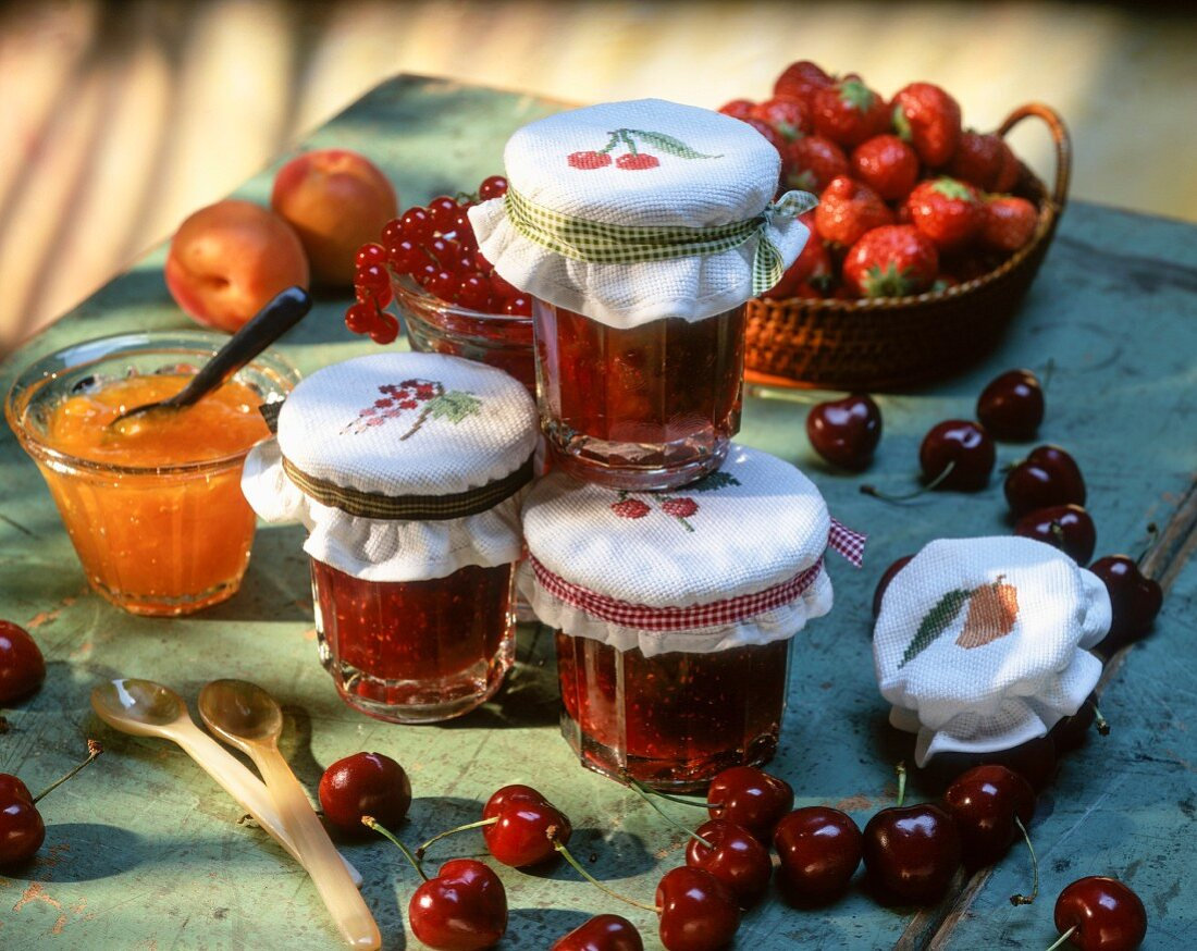 Cherry jam in jars and apricot jam