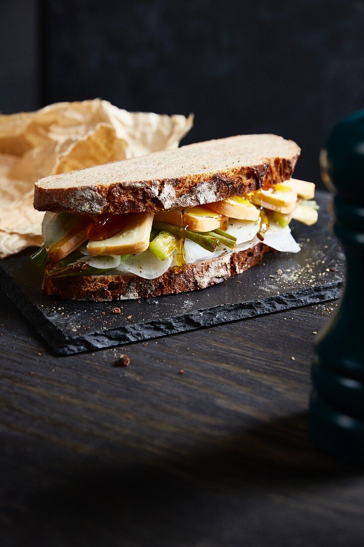 A farmhouse bread sandwich with white radish, red mould cheese and honey