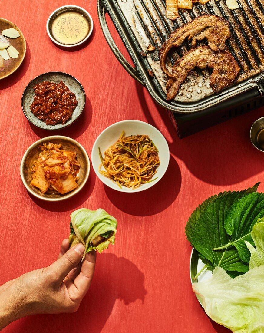 Samgyeopsal gui - grilled pork belly in a lettuce leaf, Korea