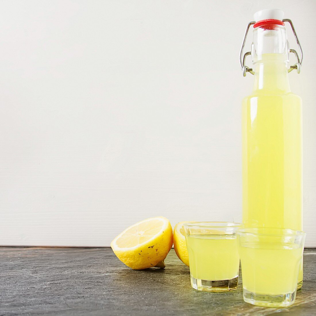 Limoncello in a bottle and glasses