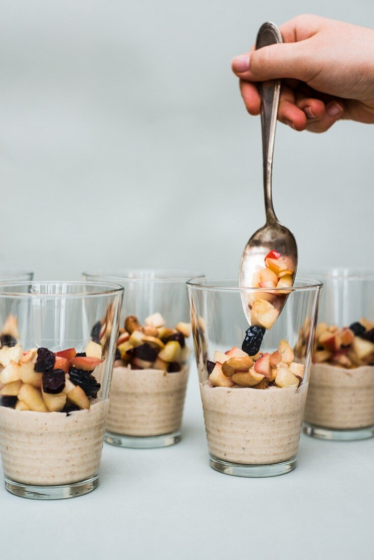 Cashew cream with fruit in glasses