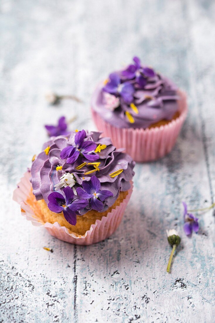 Cupcakes with violets, daisies, and dandelion petals