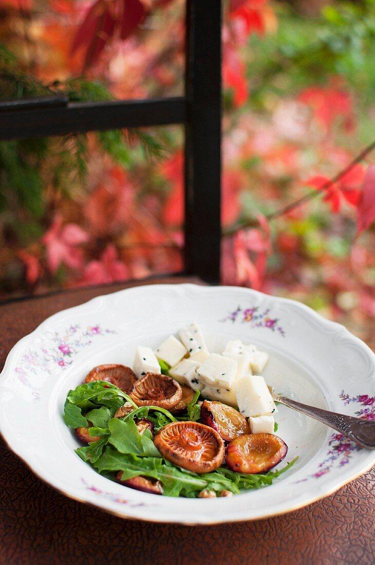 Salad with red pine mushrooms, rocket and Ser Korycinsk (Polish cheese)