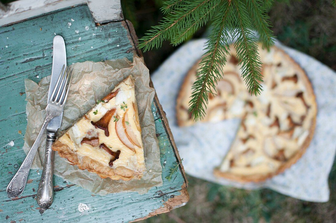 A slice of quiche with wild mushrooms, pear and goat's cheese