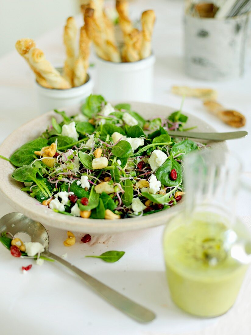 Green salad with sprouts, feta and cashews
