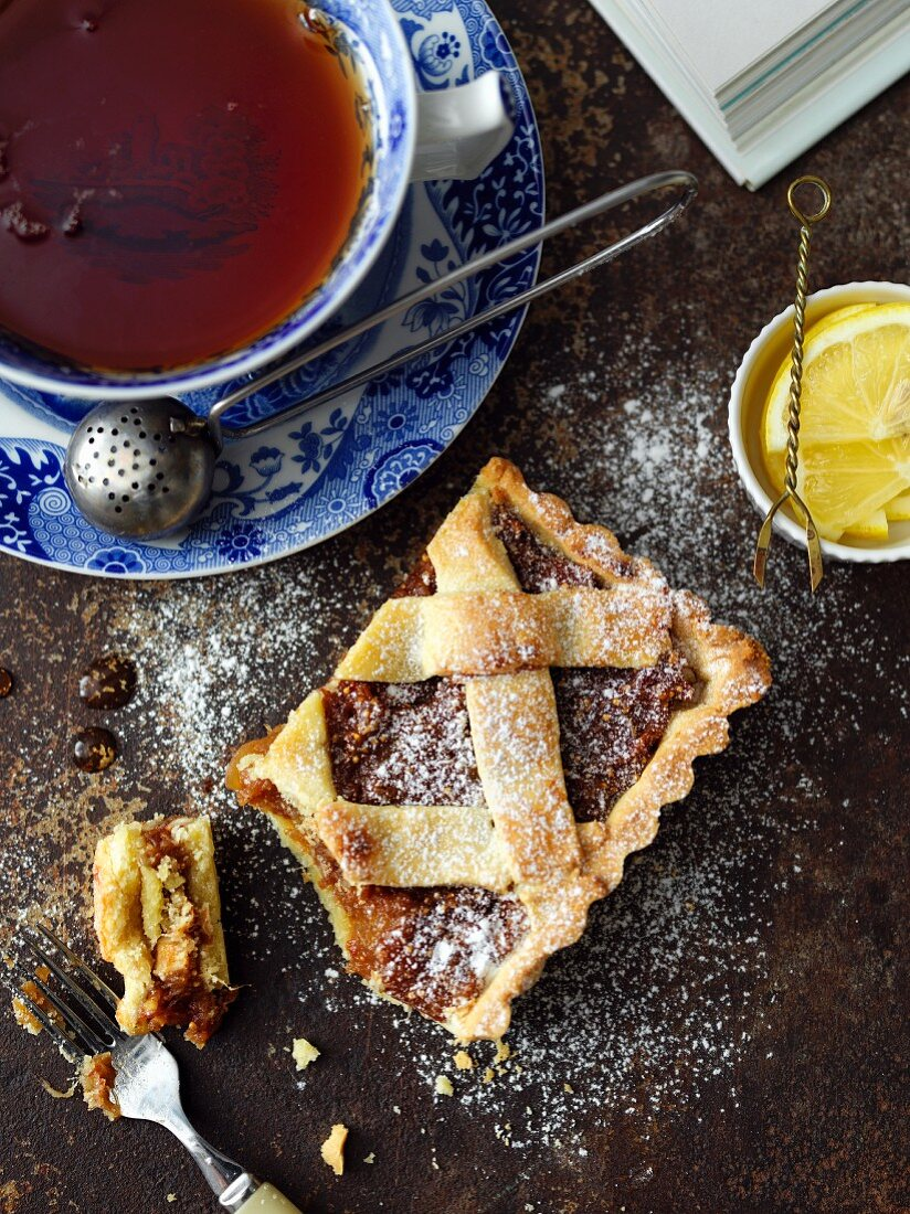 A piece of dried fruit pie and a cup of tea