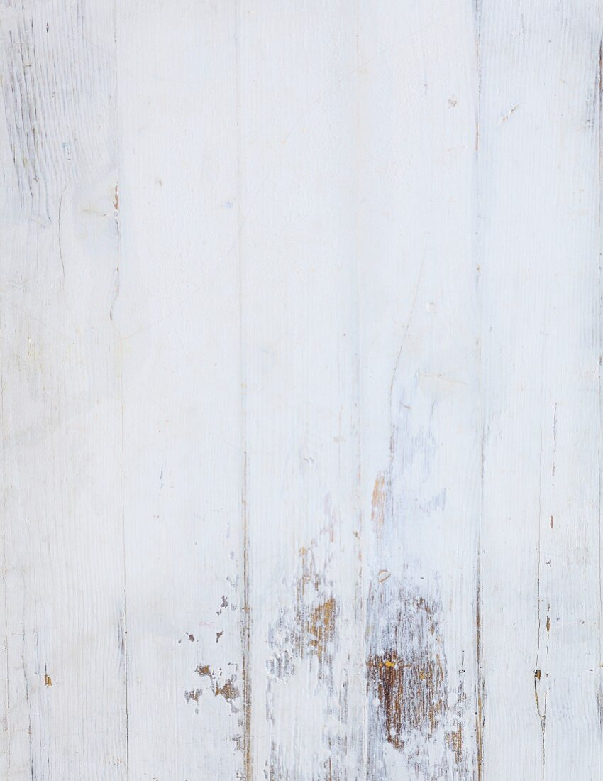 A white, painted wood background