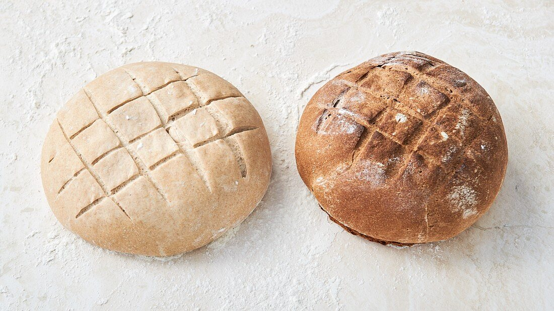 Raw bread and a baked loaf with score marks