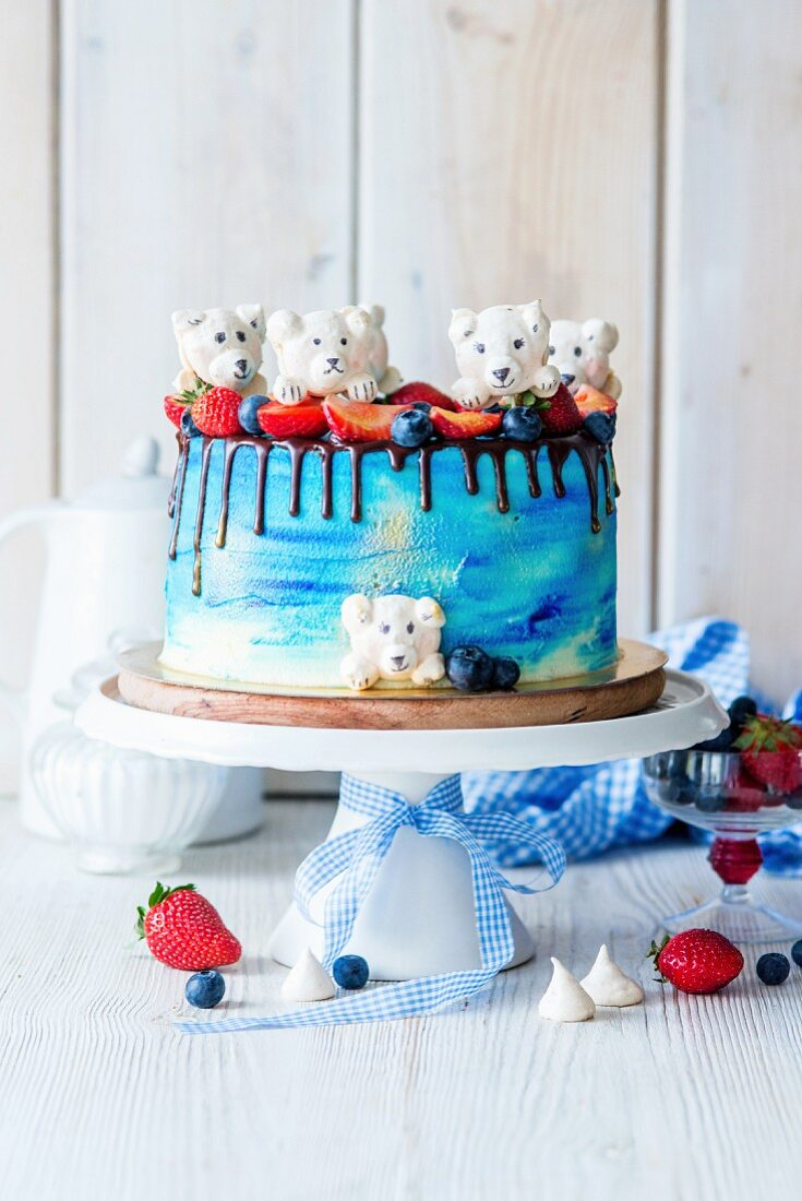 A buttercream cake decorated with meringue polar bears