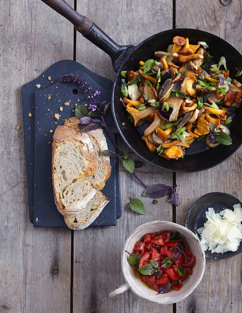 A light lunch with bread, mushrooms, and tomatoes