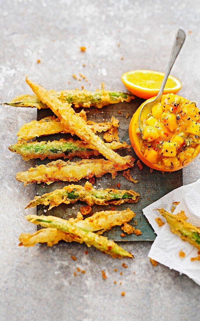 Asparagus tempura with orange and mango chutney