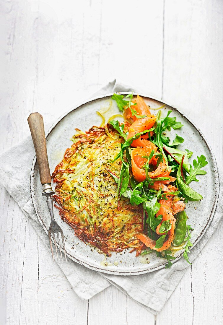 Asparagus and potato rosti with salmon and honey and lime dressing