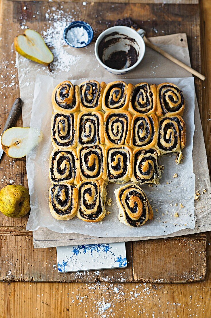 Poppy-seed cakes with pear and orange icing