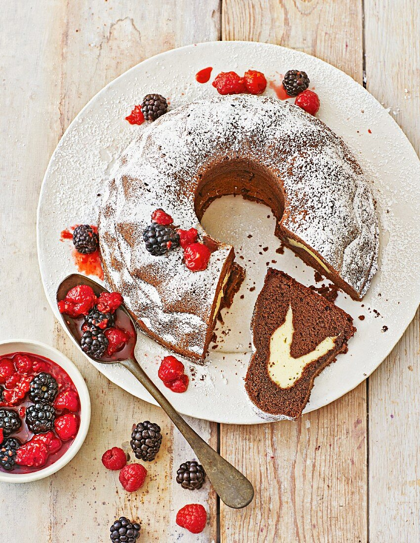 Chocolate ring cake with cream cheese filling and berry compote