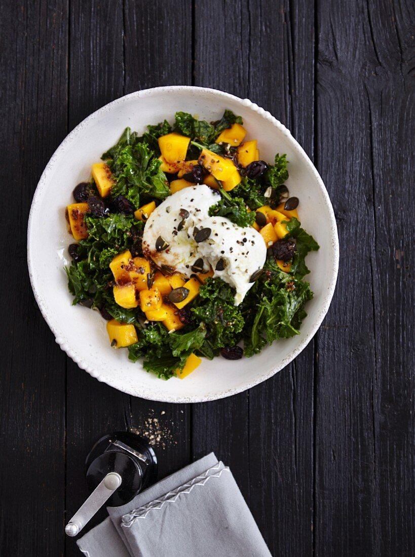 A kale salad with mango, buffalo mozzarella and pumpkin seeds - 'Green-Eyed Beauty'