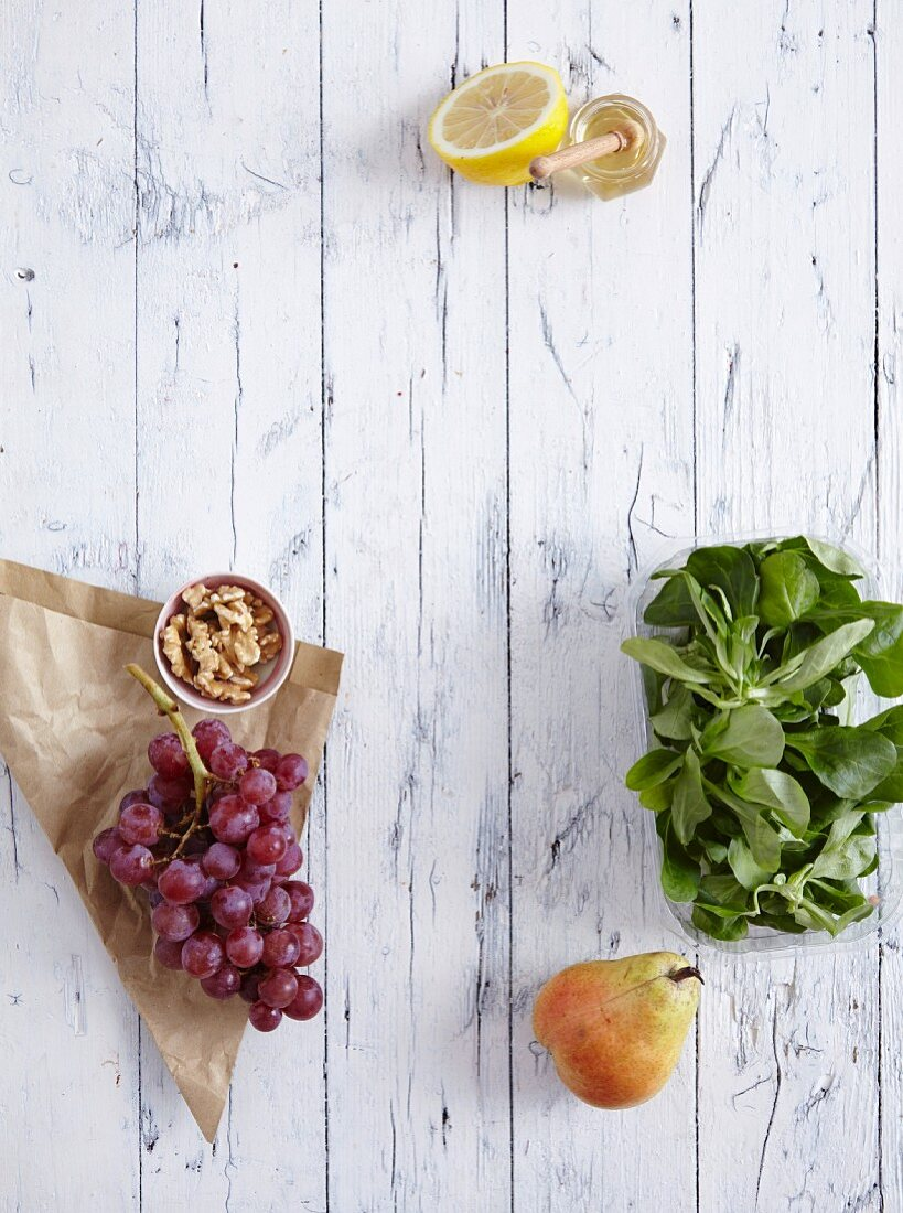 Grapes, walnut kernels, lambs lettuce and a pear