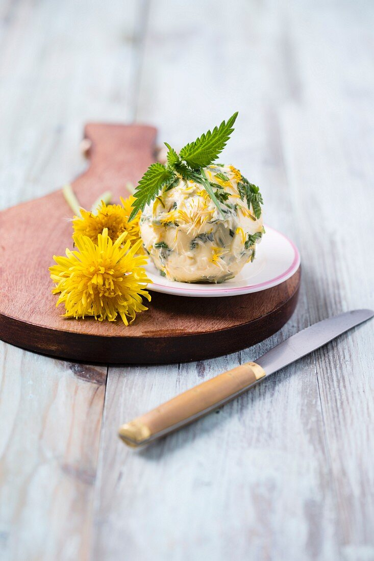 A herb butter ball with dandelions, nettles and chives