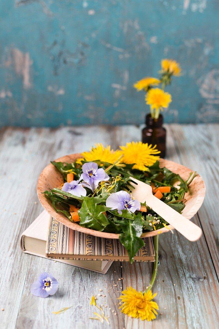 Dandelion salad with carrots and horned violets