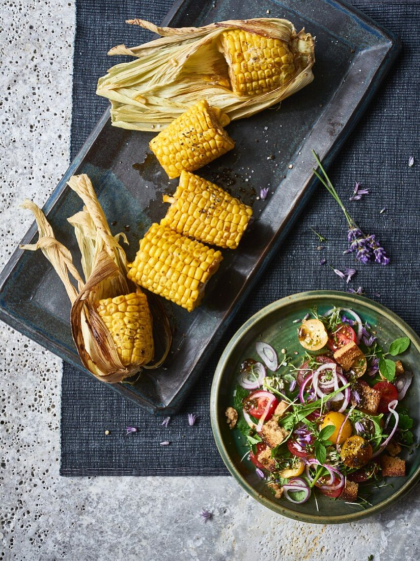 A wild tomato and bread salad with roasted sweetcorn