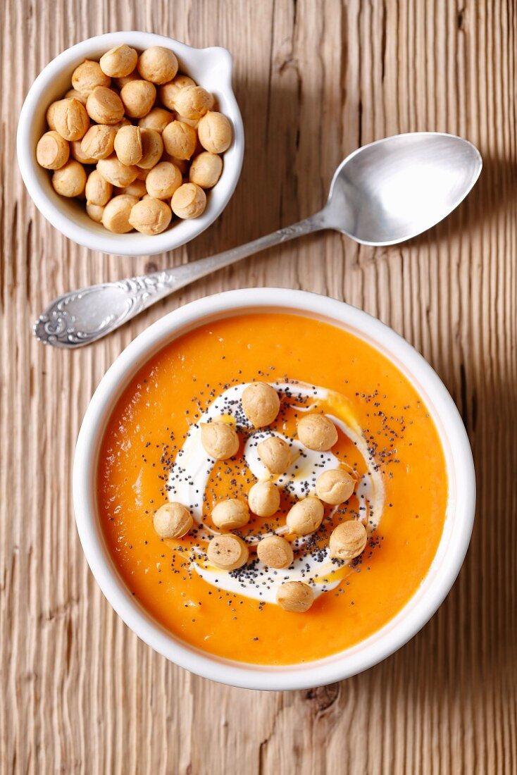 Cream of carrot soup with choux pastry balls