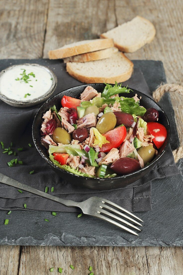 Tuna salad with olives and tomatoes