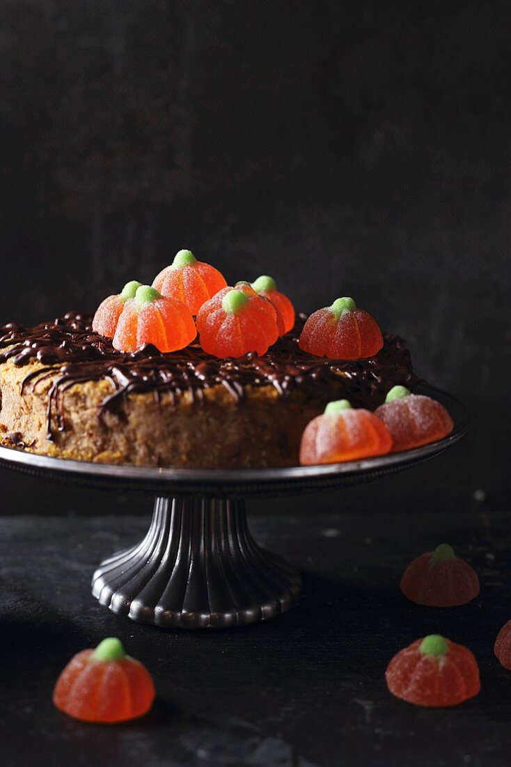 A gluten-free orange and pumpkin cake garnished with jelly confectionary